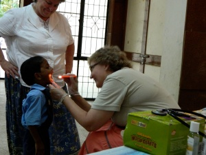 Pastor Jacque helps with health screenings for over 700 children and adults at Family Village Farm in South India.
